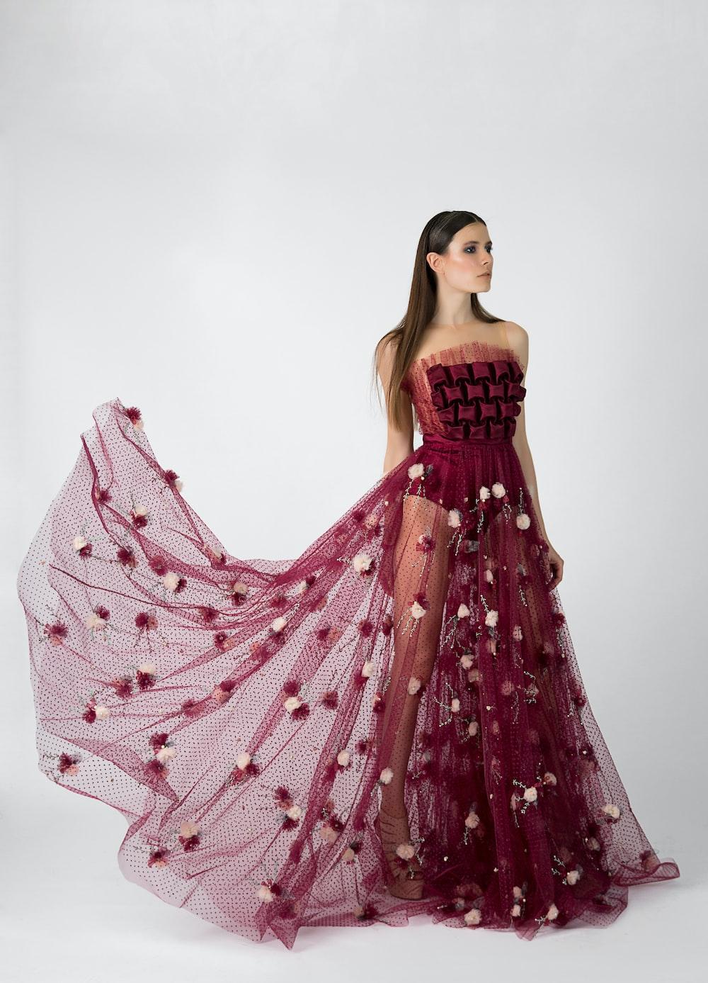 woman in maroon dress