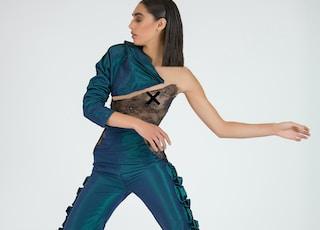 woman wearing blue dress dancing