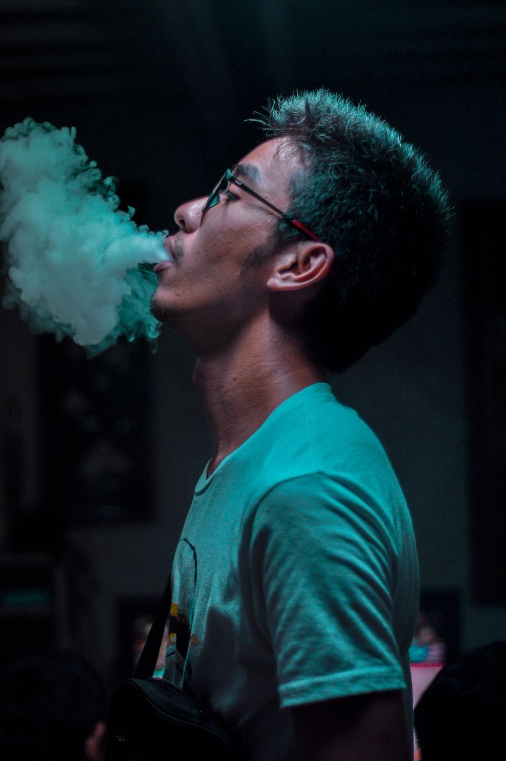 man in white shirt smoking