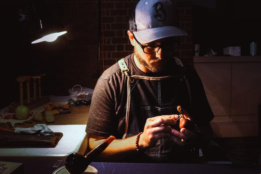 man holding precision tool