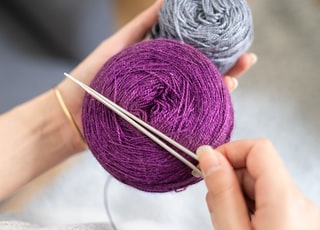 person holding yarn