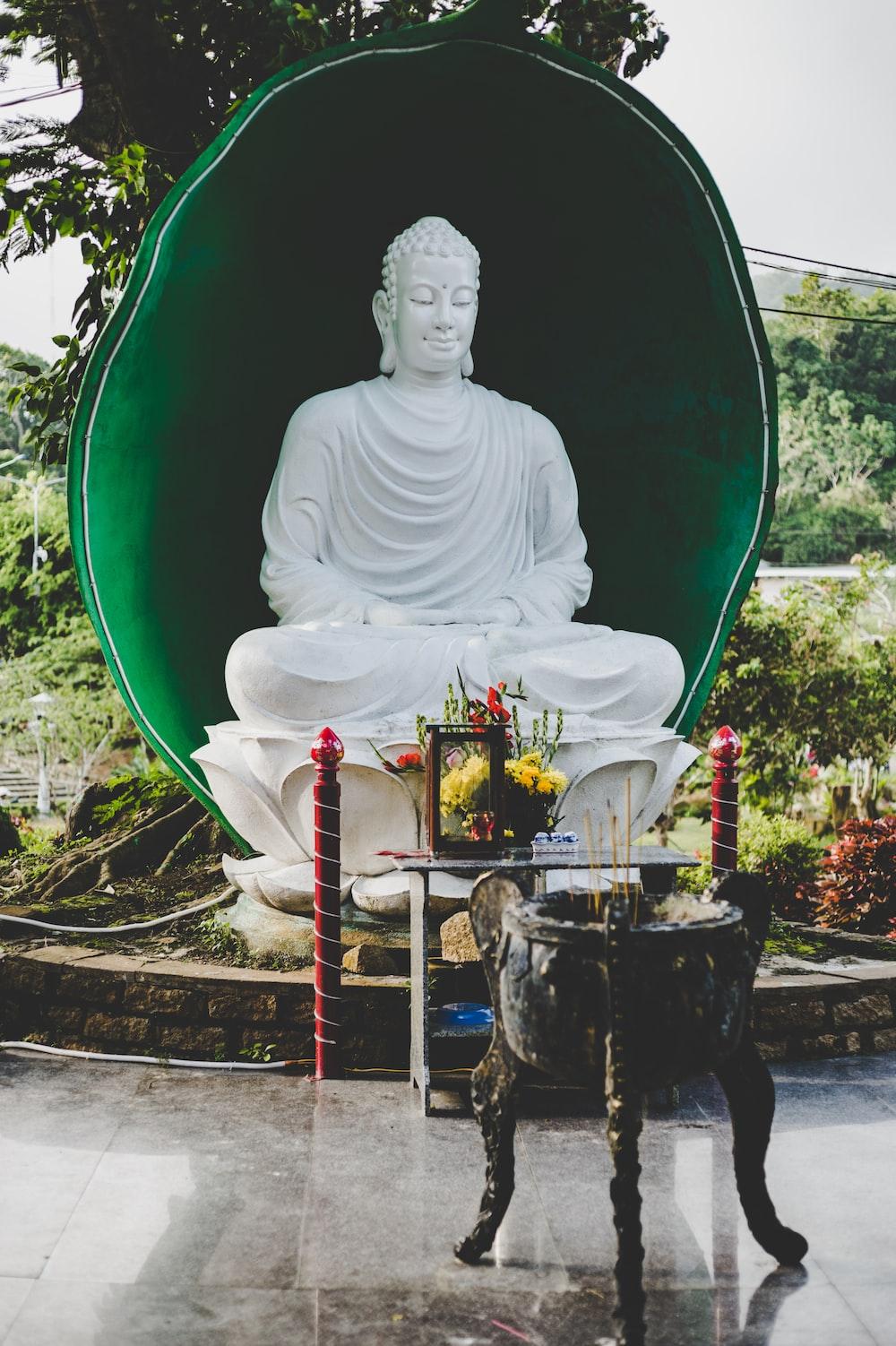 white buddha statue at daytime
