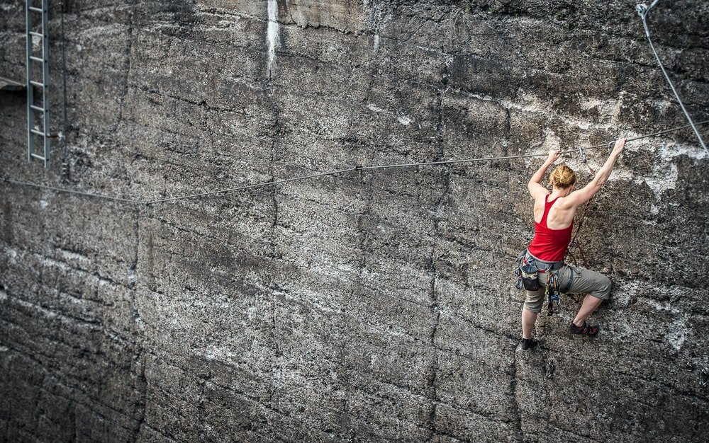unknown person climbing on wall