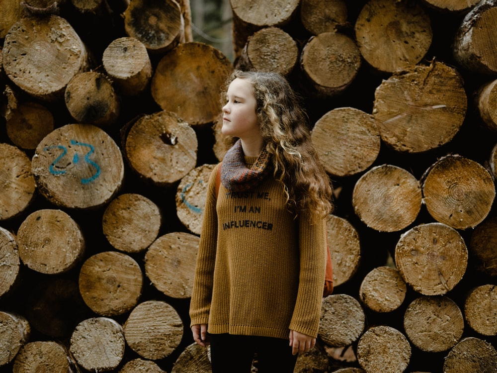 girl wearing brown knitted sweater