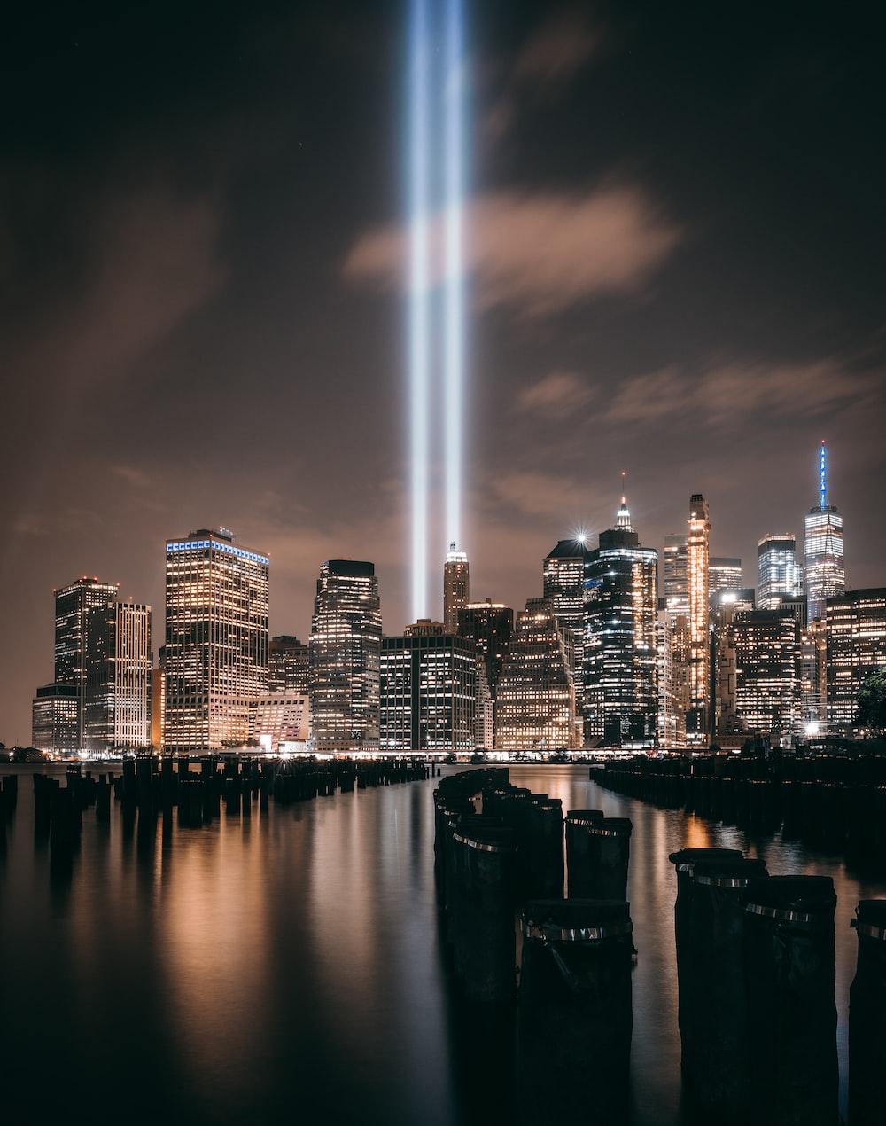 the 9/11 memorial lights over the New York City skyline