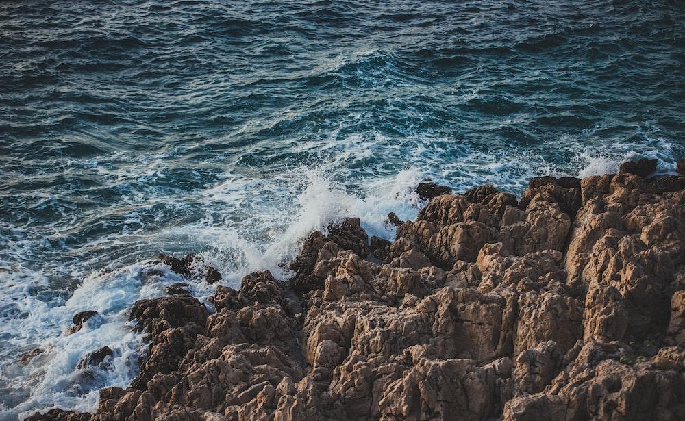 rocks ear ocean
