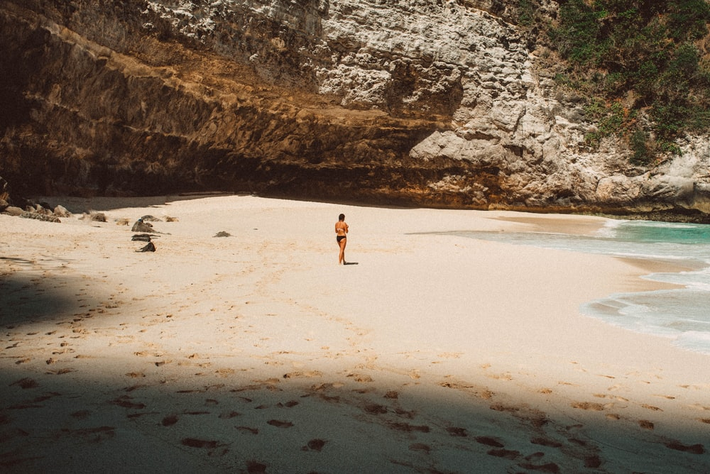 woman standing near ocean