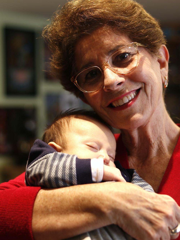 woman hugs baby while sleeping