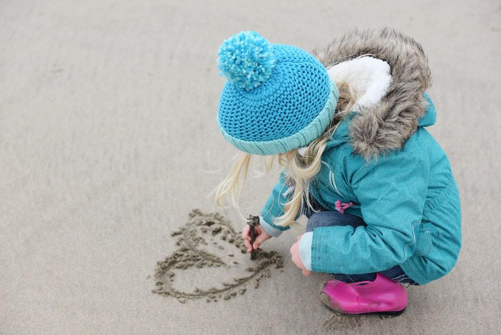 girl wears blue knit cap