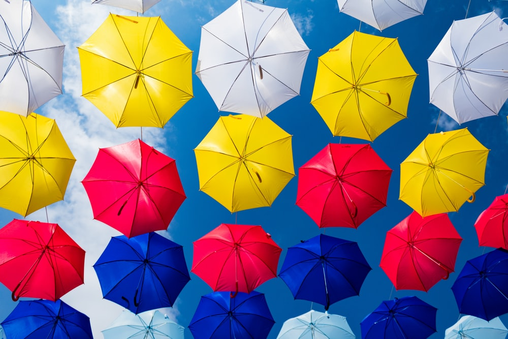 assorted-color umbrellas at daytime