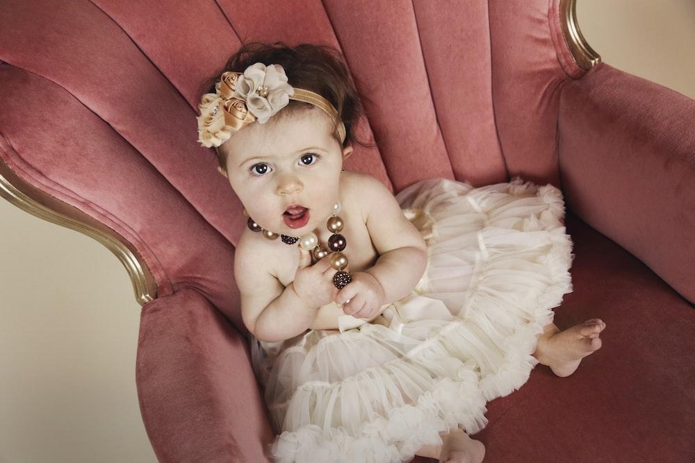 baby sitting on sofa chair