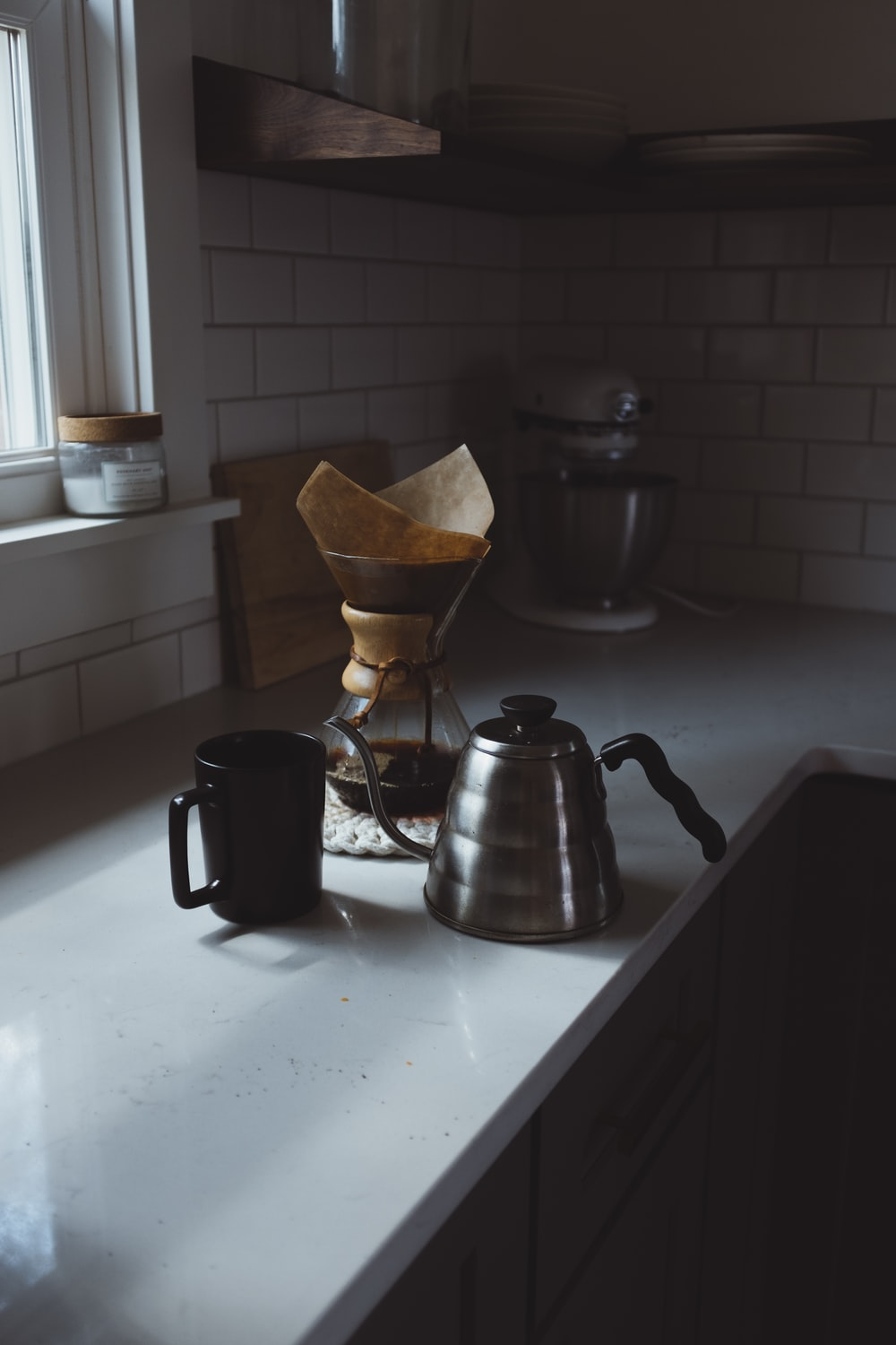 still life photography of coffee and carafe at the kitchen