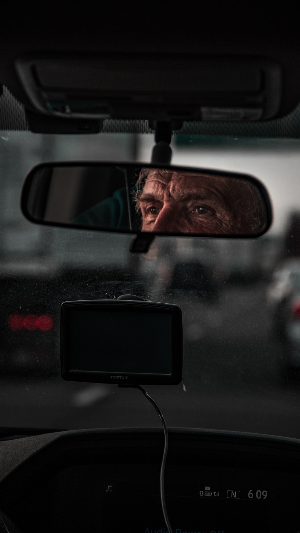 rear view mirror with man's eyes reflection