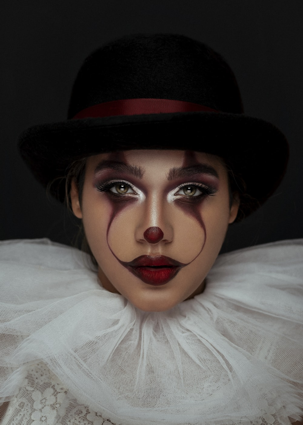 woman using joker makeup