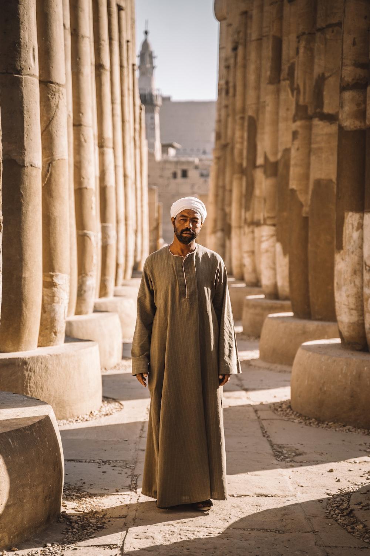 man stands between columns