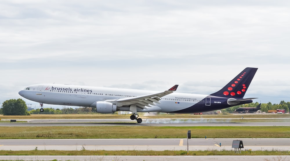 Brussels Airlines airliner about to take off from airfield during day