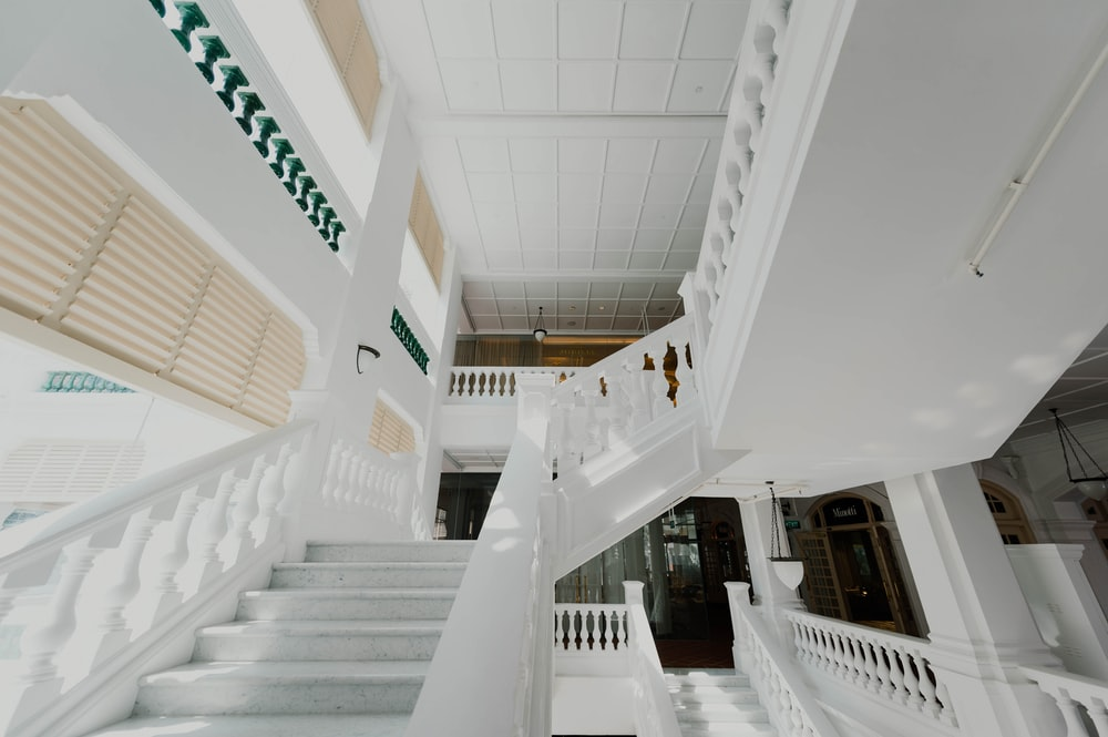 white concrete stairs of inside building view