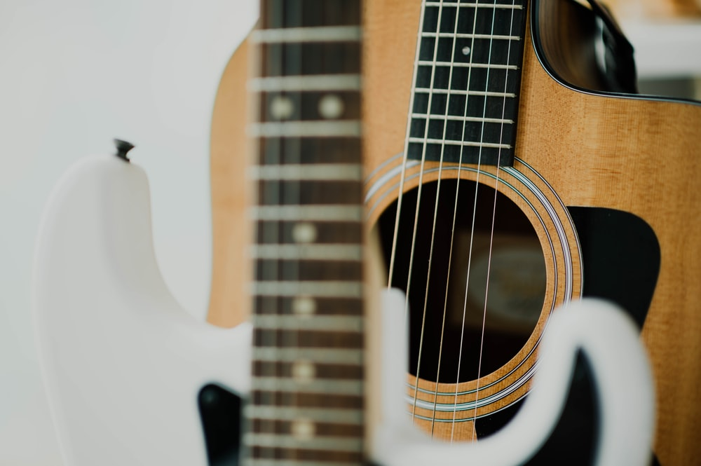 brown and black guitar