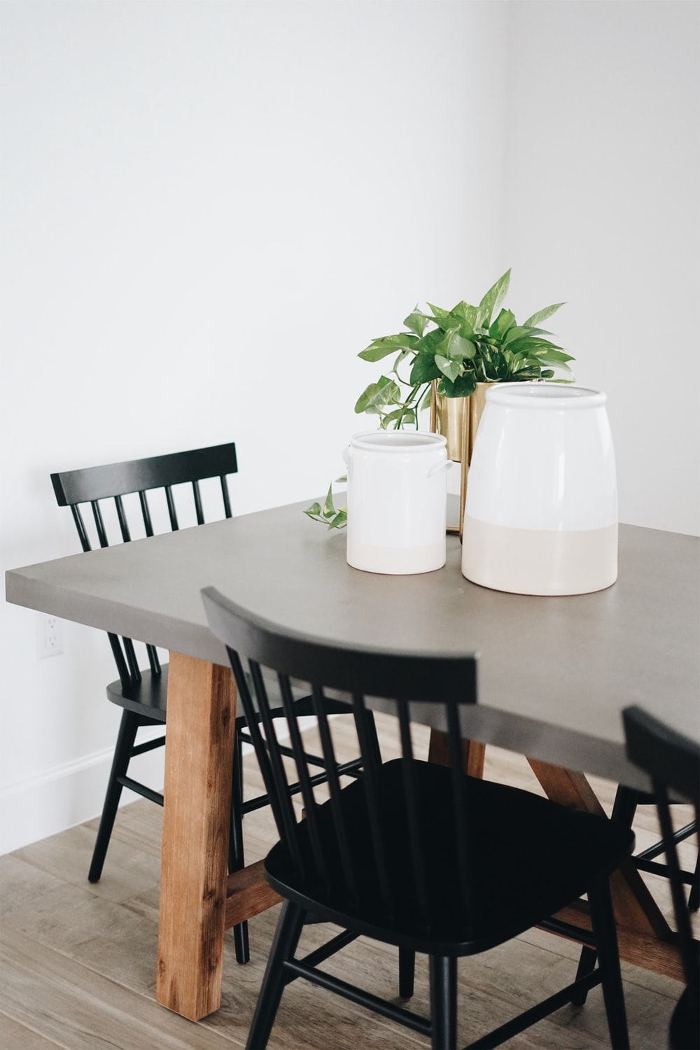 rectangular black wooden table with chairs