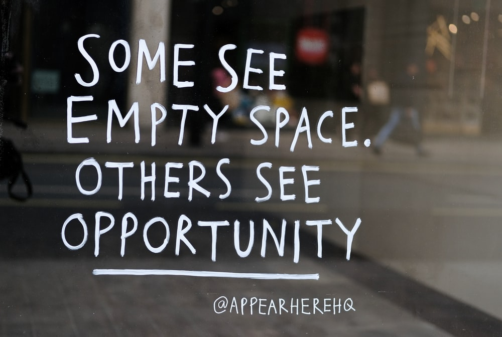 some see empty space. others see opportunity text on glass board