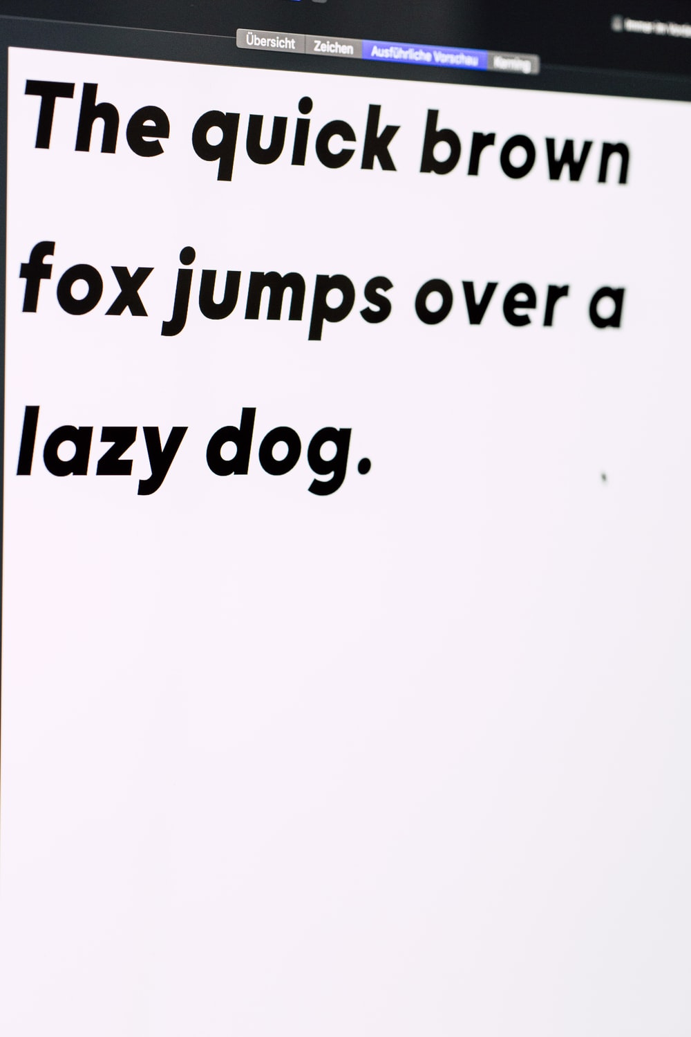 the quick brown fox jumps over a lazy dog text on white background