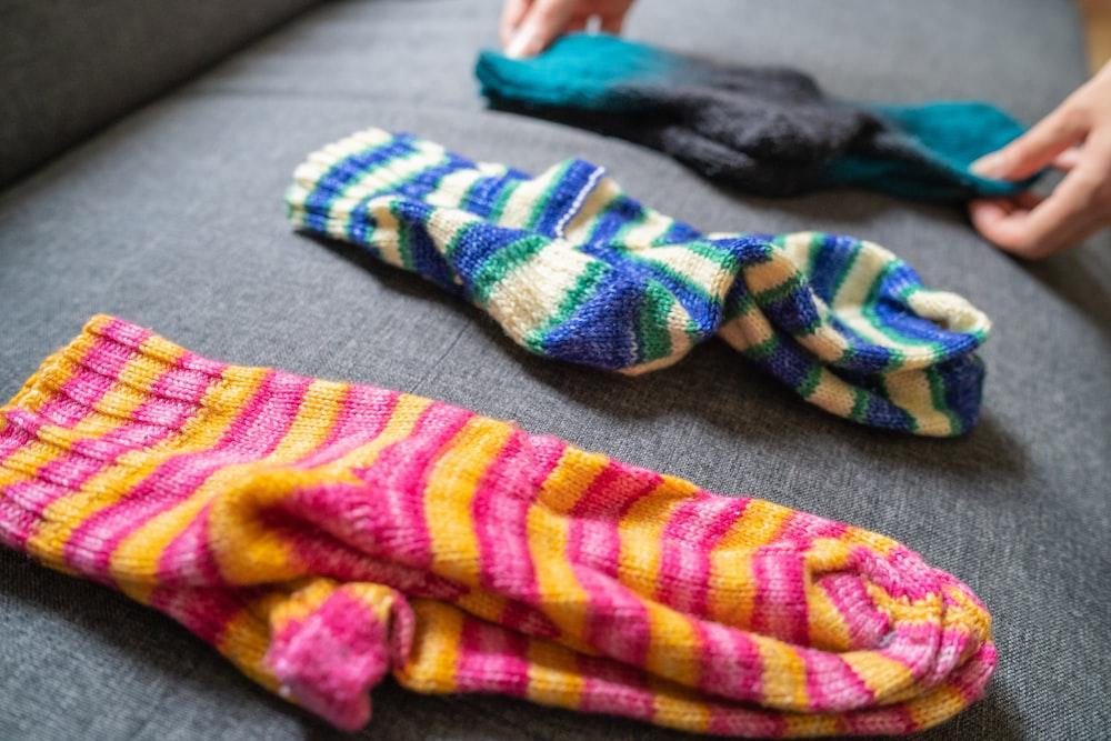 three assorted-color socks