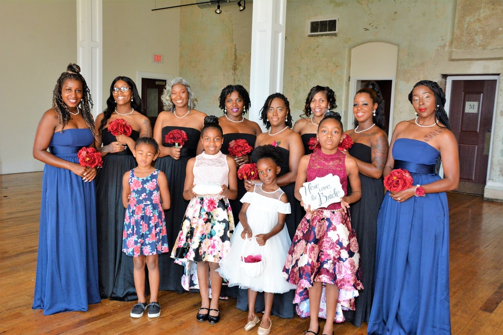 standing women wearing dresses