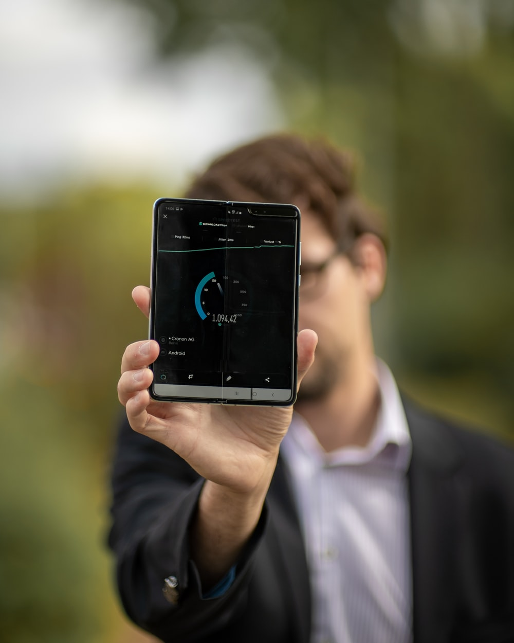 person holding Android tablet computer