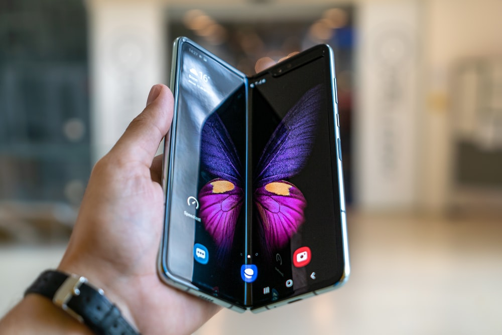 person holding black phone