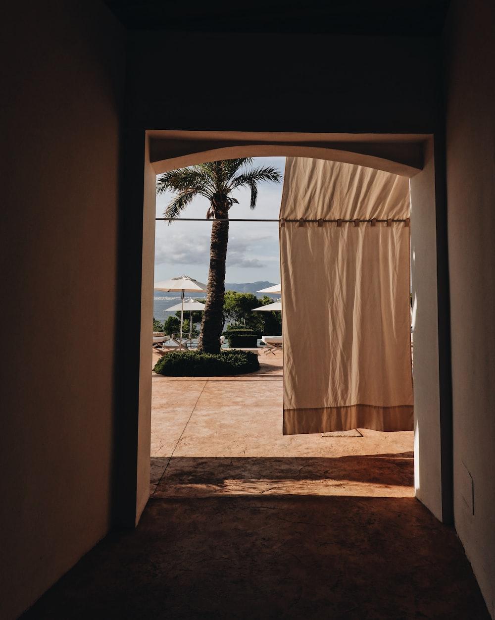 curtain hanging on rod in front of door