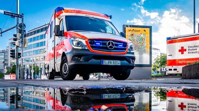 white and red Mercedes-Benz ambulace
