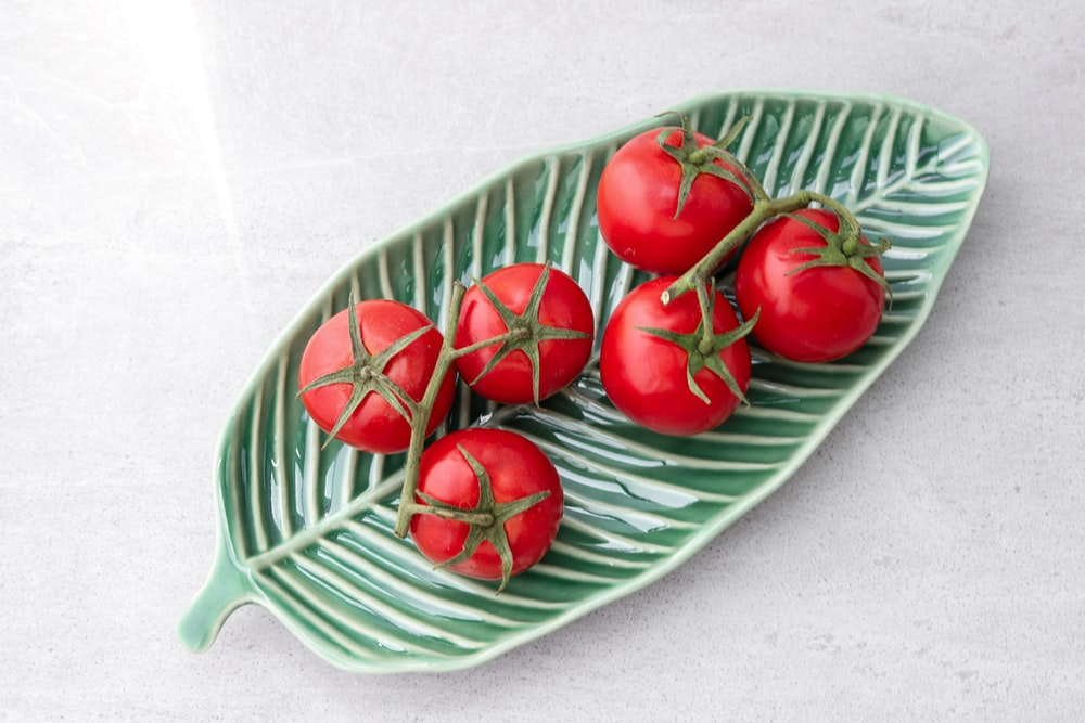 tomatoes on green leaf plate