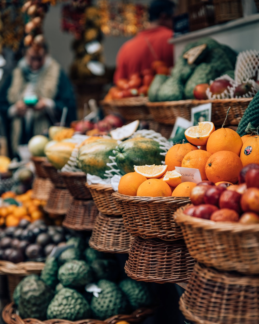 selective focus photography of displayed basket of fruits