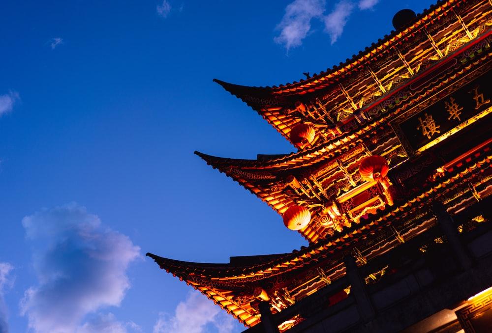 orange paper lanterns on castle roofs during daytime