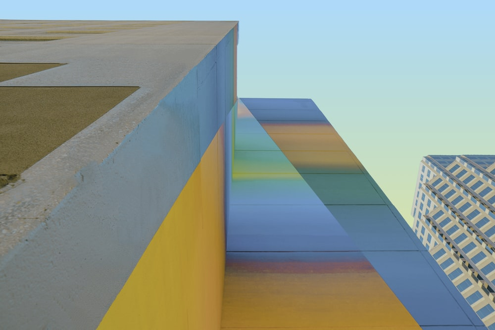multicolored concrete buildings in low-angle view photo
