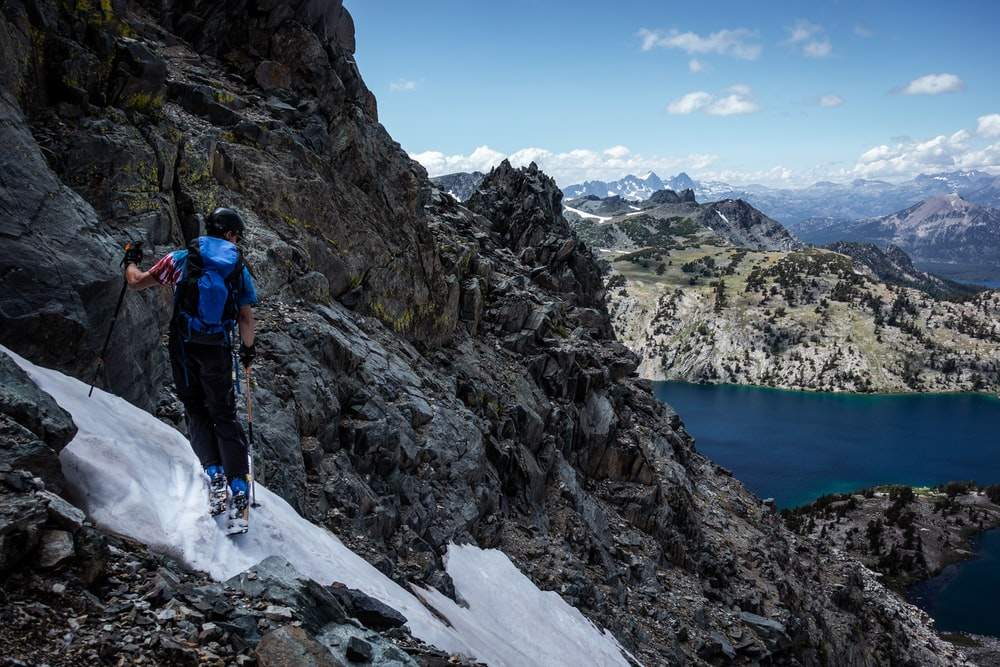 man climbing a snowy mountain