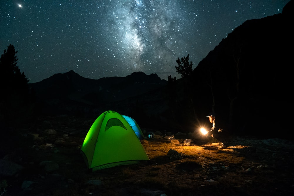 green tent near fire at night