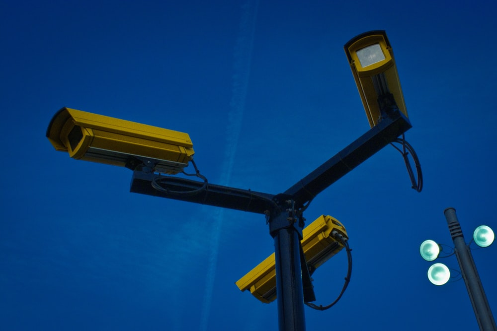 yellow surveillance camera