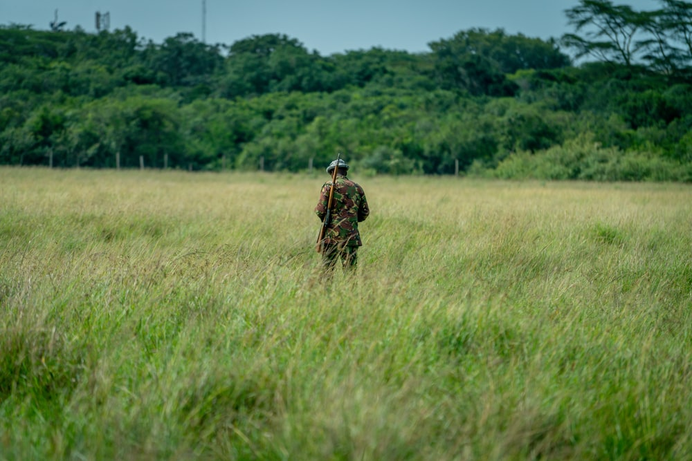 man standing in the middle of field