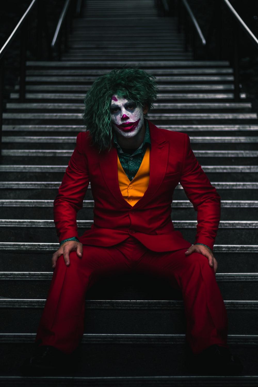 Joker sitting on stairs
