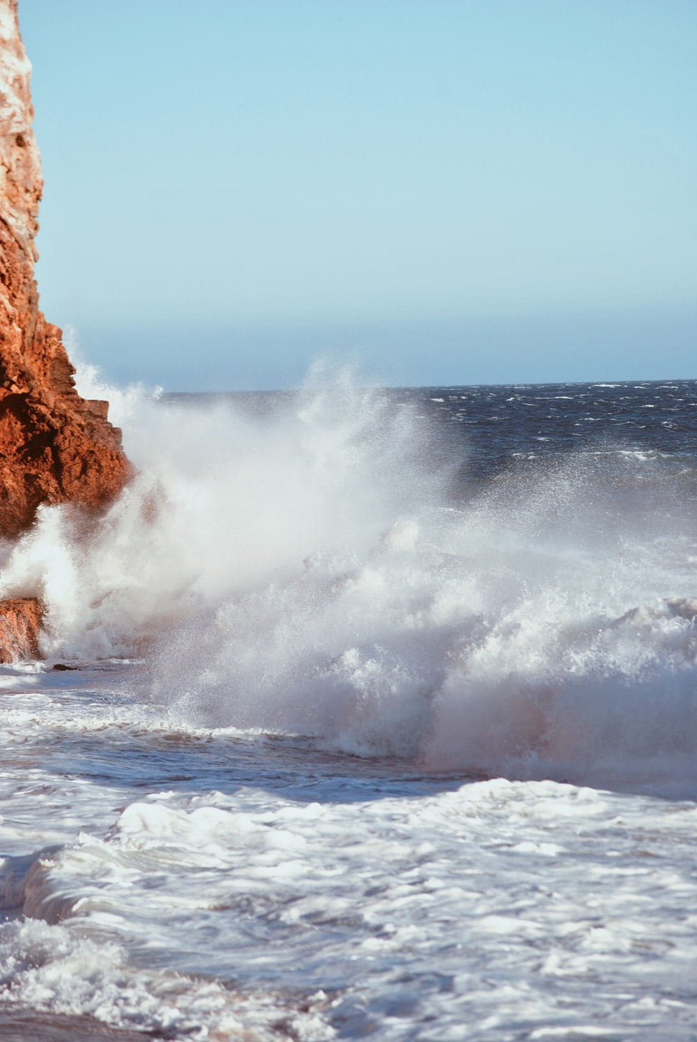 time-lapse photography of splashing sea waves