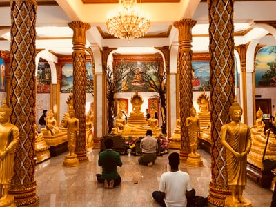 temple with people phuket teams background