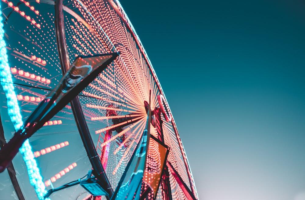 worm's eye view of a lit Ferris Wheel
