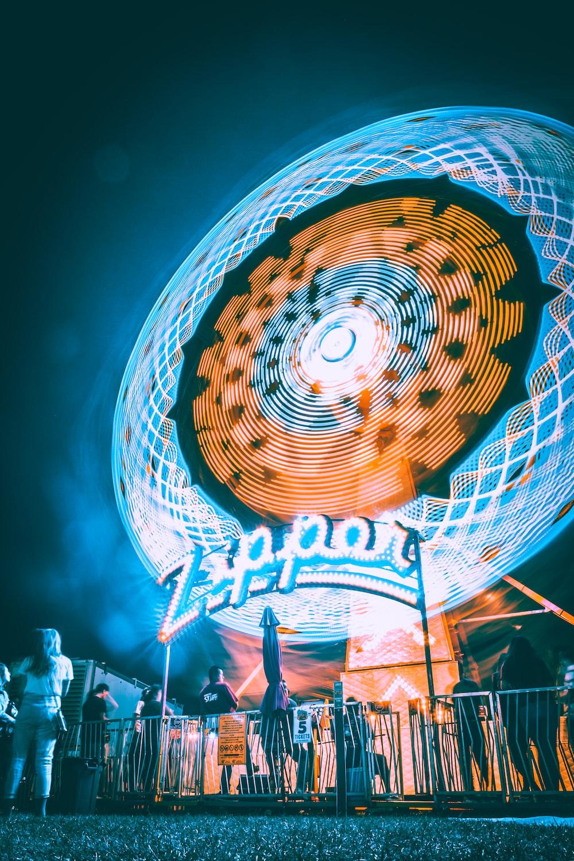 panning photo of ferris wheel