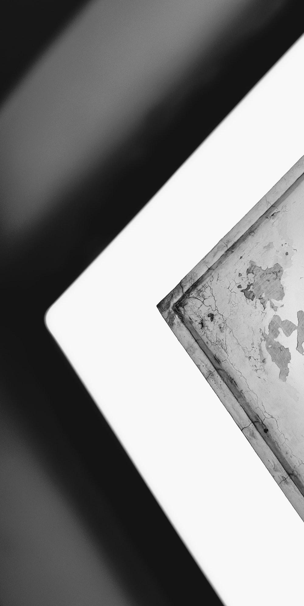 white photo frame on black surface