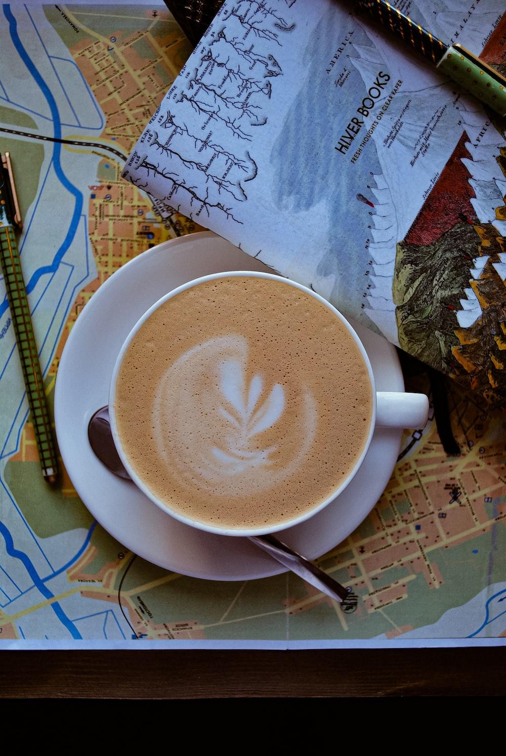 flat lay photography of coffee served on white mug