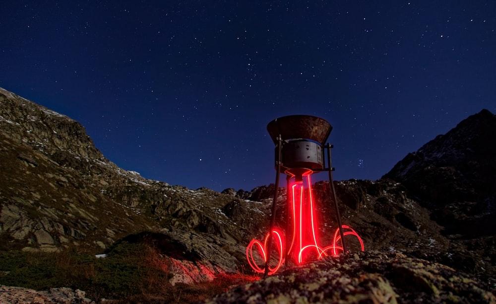 lighted rocketship at nighttime