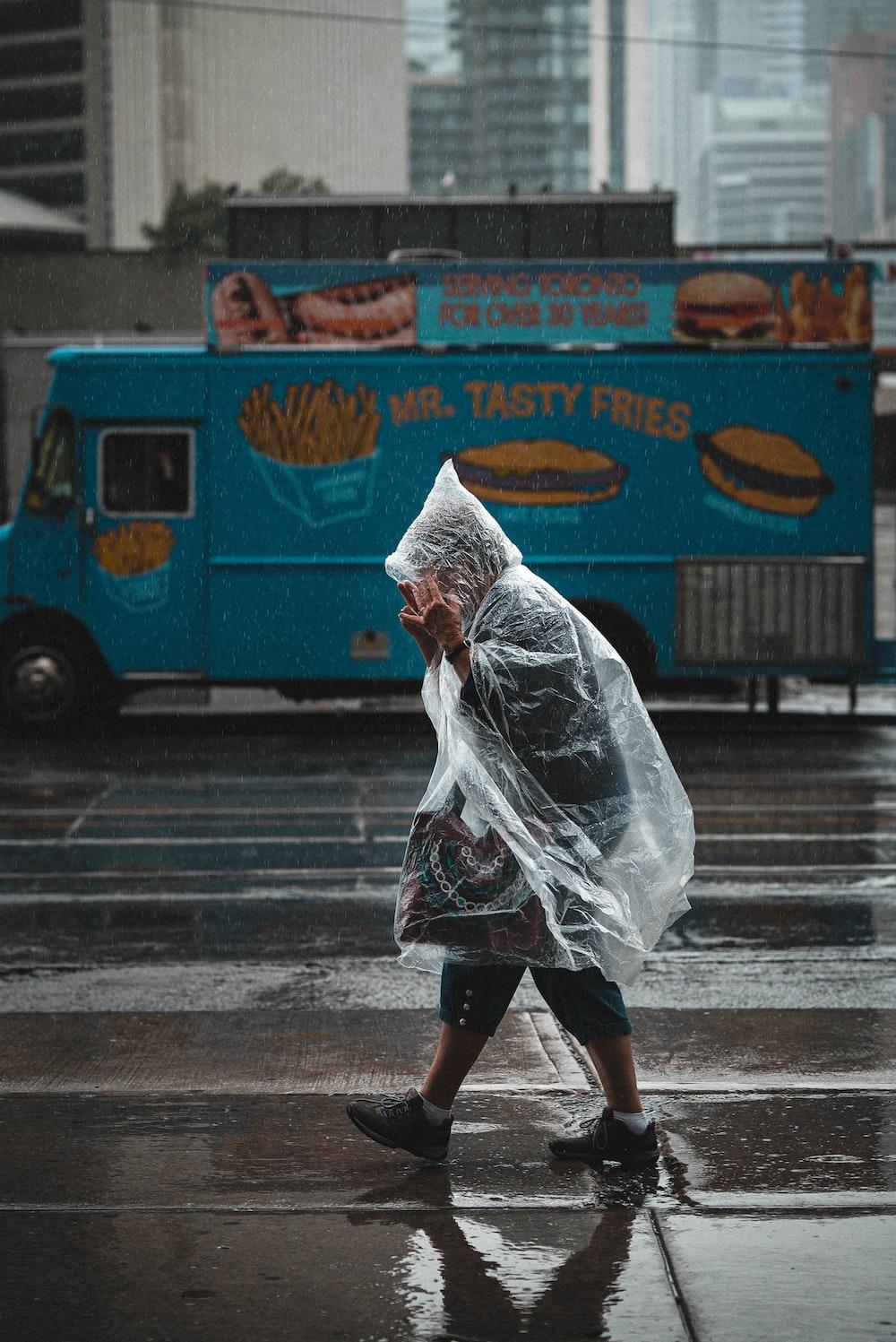 man walking wearing raincoat