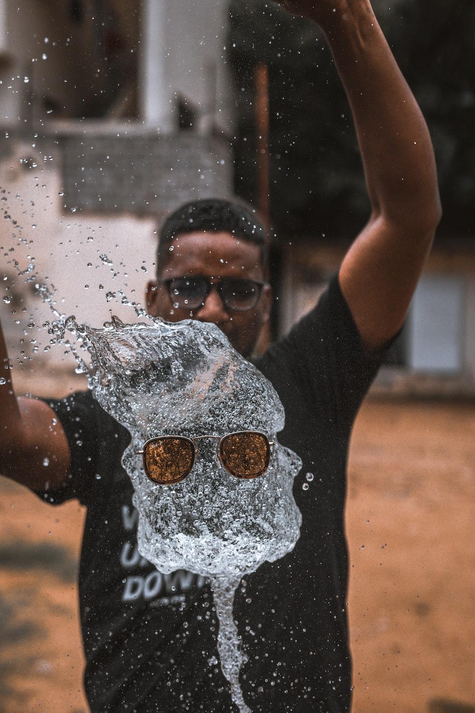 man playing water outside