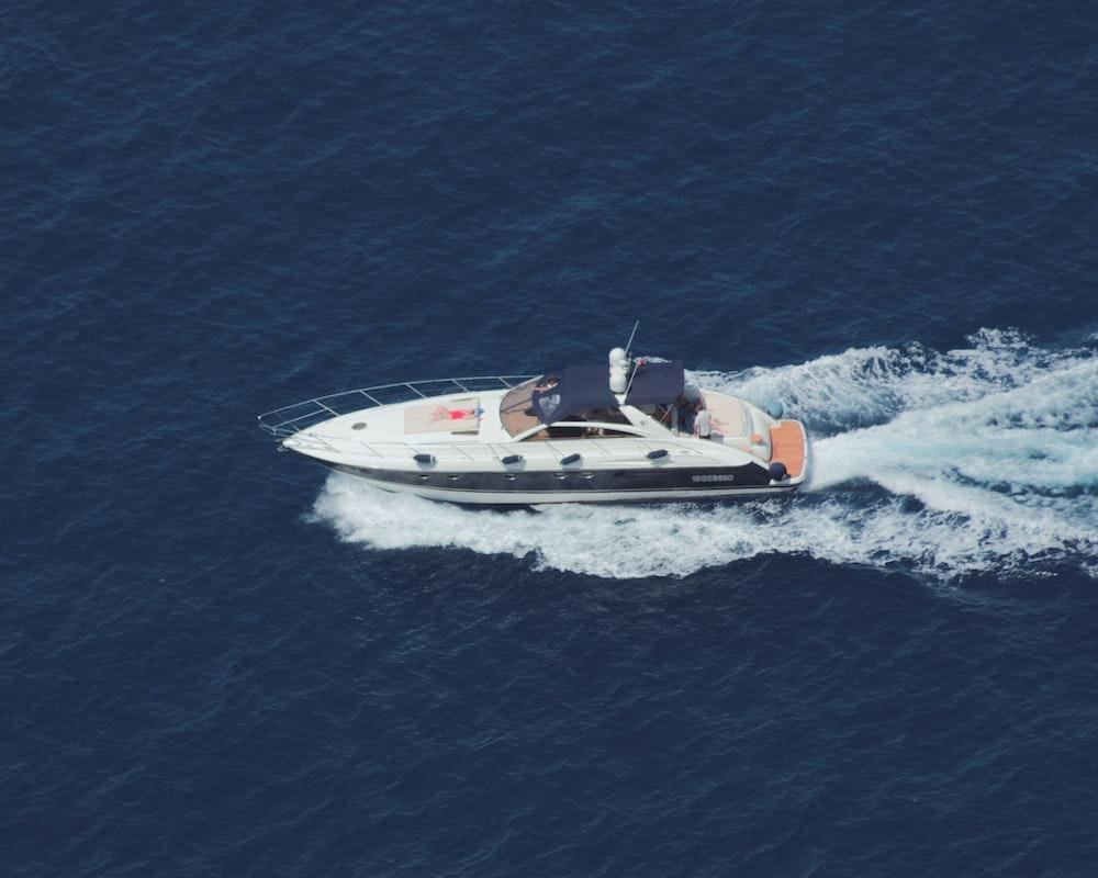 white and black speedboat on sea